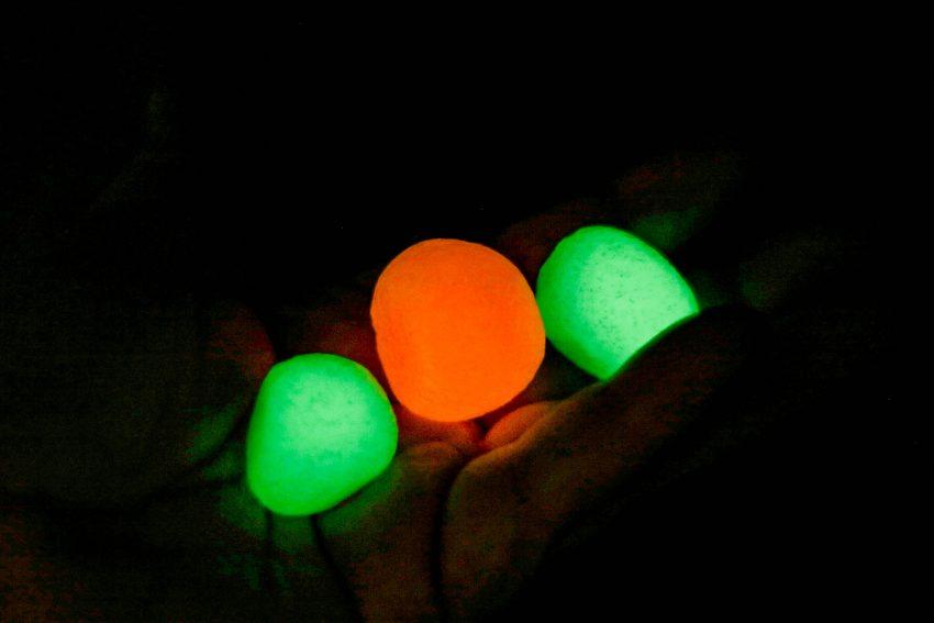 3 glowing bouncy balls in hand